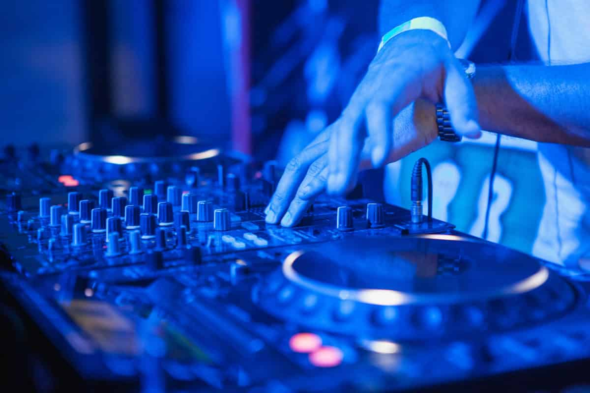 dj-playing-music-at-mixer-on-colorful-blurred-PAZNFQ5-1200x800.jpg