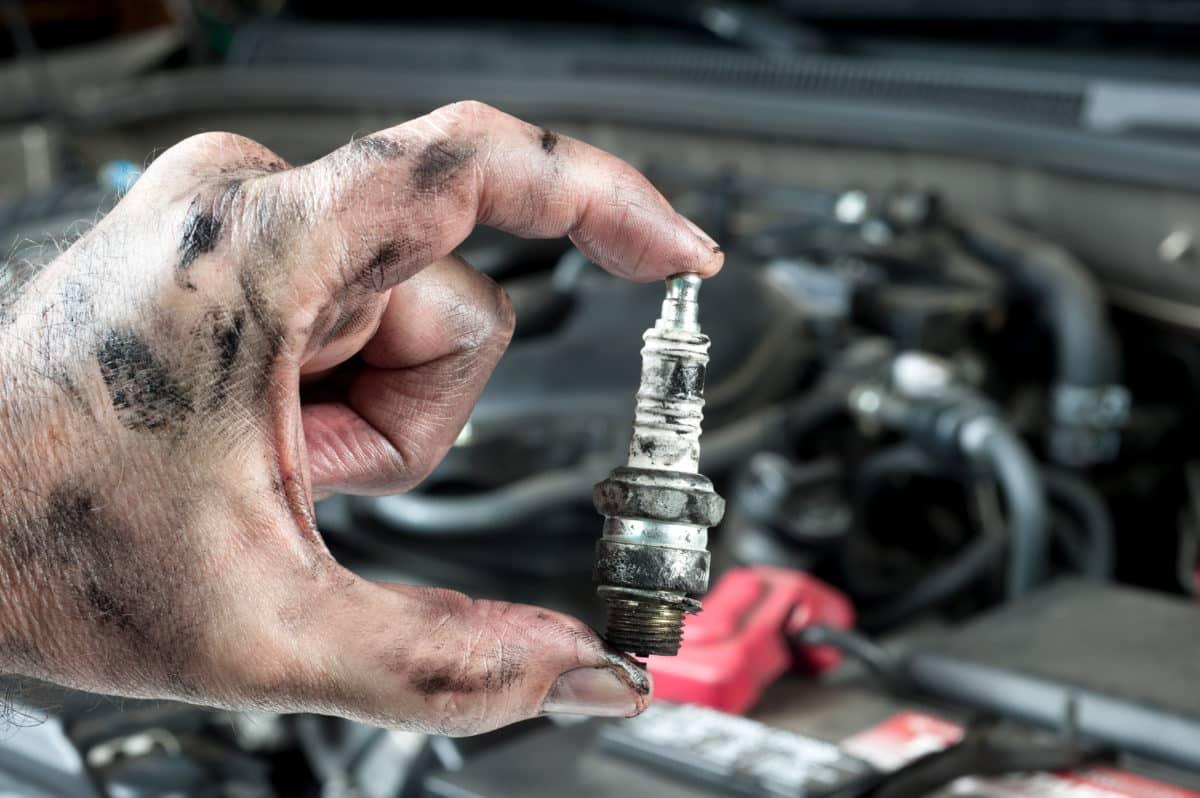 auto-mechanic-and-sparkplug-P6WTJK5-1200x798.jpg